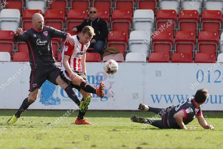 Kevin Ellison, Kyle Storer and Peter Murphy during the EFL Sky Bet League 2 match between Cheltenham Town and Morecambe at Whaddon Road, Cheltenham