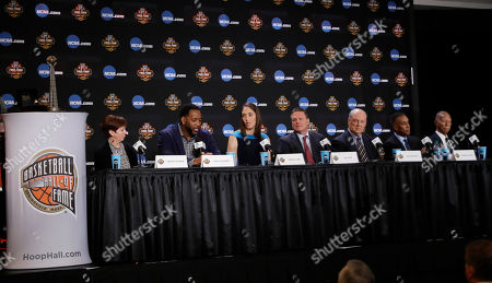 From left, Muffet McGraw, Tracy McGrady, Rebecca Lobo, Bill Self, Tom Jernstedt Mannie Jackson and Robert Hughes answer questions at the Basketball Hall of Fame news conference, in Glendale, Ariz