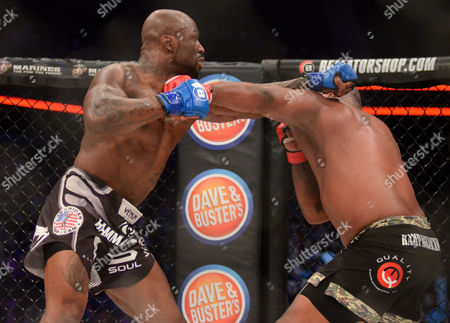Muhammed ''King Mo'' Lawal (blue tape) and Quinton ''Rampage'' Jackson (red tape) in action during Bellator 175 at Allstate Arena in Rosemont, Illinois