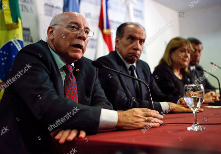Paraguay's Foreign Minister Eladio Loizaga, left, speaks during a news conference accompanied by Brazil's Foreign Minister Aloysio Nunes, from second left, Argentina's Foreign Minister Susana Malcorra, and Uruguay's Foreign Minister Rodolfo Nin Novoa, in Buenos Aires, Argentina, . The South American trade bloc called an emergency meeting of Mercosur nations' foreign ministers to discuss the Venezuelan political crisis which suspended Venezuela in December