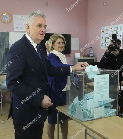 Outgoing Serbian President Tomislav Nikolic (L) accompanied by his wife Dragica (C) casts his ballot at a polling station in Belgrade, Serbia, 02 April 2017. Eleven candidates are running for the office of the President of the republic of Serbia, the term of office that will last five years and begin from the day of taking of the oath before the National Assembly.