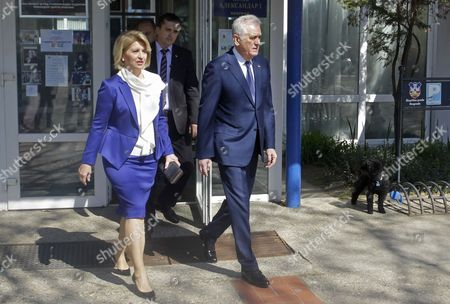 Outgoing Serbian President Tomislav Nikolic (R) accompanied by his wife Dragica (L) leave a polling station in Belgrade, Serbia, 02 April 2017. Eleven candidates are running for the office of the President of the republic of Serbia, the term of office that will last five years and begin from the day of taking of the oath before the National Assembly.