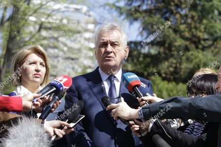 Outgoing Serbian President Tomislav Nikolic (C) addresses the media accompanied by his wife Dragica (left) at a polling station in Belgrade, Serbia, 02 April 2017. Eleven candidates are running for the office of the President of the republic of Serbia, the term of office that will last five years and begin from the day of taking of the oath before the National Assembly.