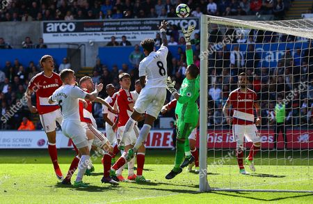 Leroy Fer of Swansea City attempts to handle the ball as Victor Valdes of Middlesbrough tries to clear during the Premier League match between Swansea City and Middlesbrough played at The Liberty Stadium, Swansea on 2nd April 2017