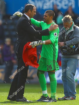 Stock Picture of Swansea City manager Paul Clement hugs Victor Valdes of Middlesbrough at full time during the Premier League match between Swansea City and Middlesbrough played at The Liberty Stadium, Swansea on 2nd April 2017