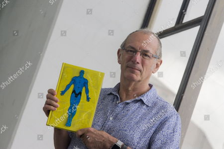 British comic book artist Dave Gibbons poses during an interview with Spanish international news agency EFE on the occassion of his participation in the 35th edition of the Barcelona International Comic Fair, in Barcelona, northeastern Spain, 02 April 2017. The FICOMIC runs from 30 March to 02 April.