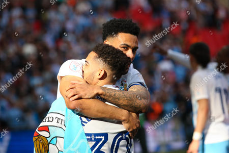 Coventry City defender Jordan Willis (2) and Coventry City defender Dion Kelly-Evans (30) celebrate the victory during the EFL Trophy Final match between Coventry City and Oxford United at Wembley Stadium, London