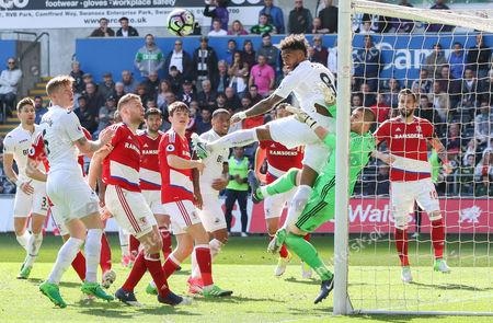 Leroy Fer of Swansea City puts Middlesbrough goalkeeper Victor Valdes under pressure