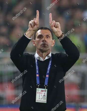 Shanghai Shenhua head coach Gus Poyet reacts during the Chinese Super League soccer match between Beijing Guoan and Shanghai Shenhua at the Workers Stadium in Beijing, China, 02 April 2017.