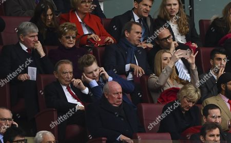 Former Arsenal players Pat Rice, top left, and Liam Brady, centre bottom, look on during the Premier League match between Arsenal and Manchester City played at the Emirates Stadium, London on 2nd April 2017