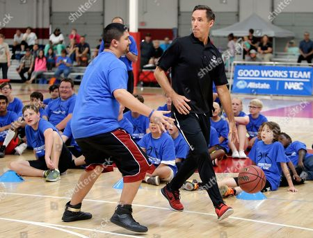 Steve Nash runs drills with a Special Olympics Arizona player during the Allstate NABC Good Works Day on in Phoenix, AZ
