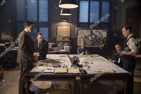 Stock Photo of 'Maigret - Night at the Crossroads' - Leo Staar as Lapointe, Kevin McNally as Grandjean, Rowan Atkinson as Maigret, Aidan McArdle as Judge Cormeliau and Shaun Dingwall as Janvier.