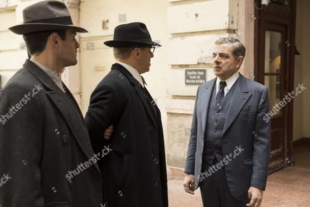 Stock Picture of 'Maigret - Night at the Crossroads' - Rowan Atkinson as Maigret, Leo Staar as Lapointe and Tom Wlaschiha as Andersen.