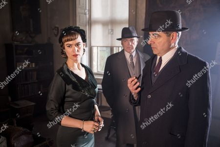 Stock Picture of 'Maigret - Night at the Crossroads' - Rowan Atkinson as Maigret, Mia Jexen as Else and Kevin McNally as Grandjean.