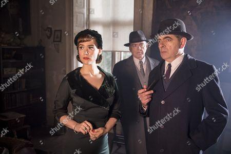 Stock Image of 'Maigret - Night At The Crossroads' - Rowan Atkinson As Maigret, Mia Jexen As Else And Kevin McNally As Grandjean.