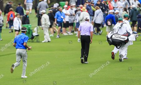 Brandt Snedeker of the US (L) runs up the third fairway to catch up with playing partner Steven Stricker of the US (R) during a practice round on the course at the 2017 Masters Tournament at the Augusta National Golf Club in Augusta, Georgia, USA, 03 April 2017. The Masters Tournament is held 06 April through 09 April 2017.