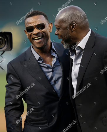Rickey Henderson, Dave Stewart Former Oakland Athletic and Baseball Hall of Fame inductee Rickey Henderson, left, laughs with former Athletics pitcher Dave Stewart after a ceremony dedicating Rickey Henderson field prior to the baseball game against the Los Angeles Angels, in Oakland, Calif