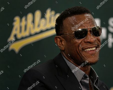 Former Oakland Athletic and Baseball Hall of Fame inductee Rickey Henderson smiles during a media conference prior to the baseball game against the Los Angeles Angels, in Oakland, Calif. The Oakland Athletics will open their 50th season at the Oakland Coliseum by dedicating Rickey Henderson Field