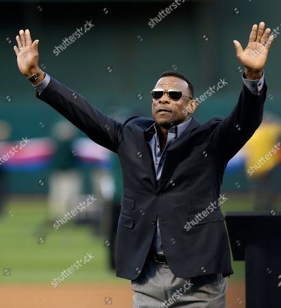 Former Oakland Athletic and Baseball Hall of Fame inductee Rickey Henderson waves to fans after a ceremony dedicating Rickey Henderson Field prior to the baseball game against the Los Angeles Angels, in Oakland, Calif