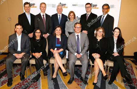 Katie Couric, Dr. David M. Barrett, Dr. Rizwan Haq, Dr. Gregory L. Beatty, Dr. Meenakshi G. Hegde, Dr. Marcela V. Maus, Dr. John T. Wilson, Dr. Jennifer A. Wargo, Dr. Marie Bleakley Back row, left to right, Dr. Michael D. Farwell, Dr. Daniel A. Bachovchin, Dr. Thomas Lynch of BMS, Journalist and Stand Up To Cancer Co-Founder Katie Couric, Dr. David M. Barrett, Dr. Rizwan Haq, front row, left to right, Dr. Gregory L. Beatty, Dr. Meenakshi G. Hegde, Dr. Marcela V. Maus, Dr. John T. Wilson, Dr. Jennifer A. Wargo, and Dr. Marie Bleakley, recipients of the 2017 SU2C Innovative Research Grants on at the Marriott Marquis Hotel in Washington, DC