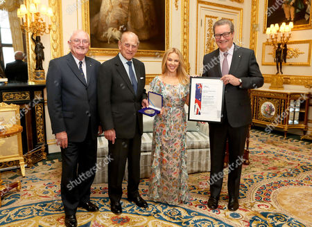 Prince Philip (second left), Patron of the Britain-Australia Society, presents Kylie Minogue with the Britain-Australia Society Award for 2016, with Britain-Australia Society chairman Peter Benson (left) and Australian High Commissioner to the the UK Alexander Downer, during a private audience in the White Drawing Room at Windsor Castle, in Berkshire.