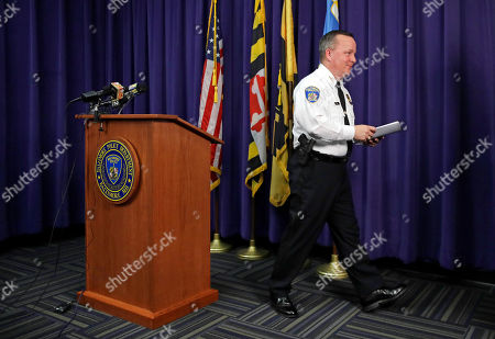 Baltimore Police Department Commissioner Kevin Davis leaves a news conference at the department's headquarters in Baltimore, after responding to the Department of Justice's request for a 90-day delay of a hearing on its proposed overhaul of the police department