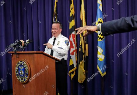 Baltimore Police Department Commissioner Kevin Davis, left, and a spokesman point to a reporter during a news conference at the department's headquarters in Baltimore, in response to the Department of Justice's request for a 90-day delay of a hearing on its proposed overhaul of the police department