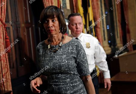 Catherine Pugh, Kevin Davis Baltimore Mayor Catherine Pugh, left, departs a news conference with Baltimore Police Department Commissioner Kevin Davis at City Hall in Baltimore, after speaking in response to the Department of Justice's request for a 90-day delay of a hearing on its proposed overhaul of the Baltimore Police Department
