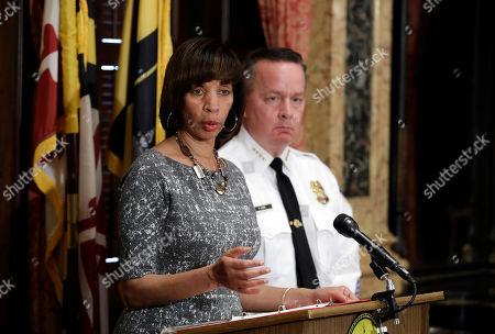 Catherine Pugh, Kevin Davis Baltimore Mayor Catherine Pugh, left, speaks alongside Baltimore Police Department Commissioner Kevin Davis at a news conference at City Hall in Baltimore, in response to the Department of Justice's request for a 90-day delay of a hearing on its proposed overhaul of the Baltimore Police Department