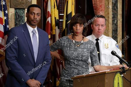 Catherine Pugh, Kevin Davis, David Ralph Interim City Solicitor David Ralph, from left, Baltimore Mayor Catherine Pugh and Baltimore Police Department Commissioner Kevin Davis listen to a reporter's question during a news conference at City Hall in Baltimore, in response to the Department of Justice's request for a 90-day delay of a hearing on its proposed overhaul of the Baltimore Police Department