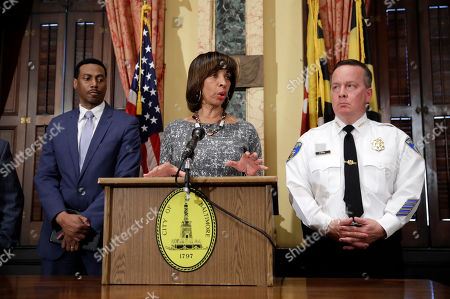 Catherine Pugh, Kevin Davis, David Ralph Baltimore Mayor Catherine Pugh, center, speaks alongside Interim City Solicitor David Ralph, left, and Baltimore Police Department Commissioner Kevin Davis at a news conference at City Hall in Baltimore, in response to the Department of Justice's request for a 90-day delay of a hearing on its proposed overhaul of the Baltimore Police Department