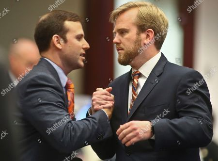 Chris Sprowls, James Grant Rep. Chris Sprowls, left, R-Clearwater, is congratulated by Rep. James Grant, R-Tampa, after his bill to regulate transportation network companies such as Uber and Lyft passed a second reading at the Florida Capitol, in Tallahassee, Fla