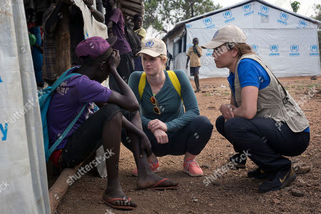 Stock Picture of Twelve-time Olympic medalist for USA swimming team Natalie Coughlin, right, speaks with a young South Sudanese refugee at the Imvepi Camp in Northern Uganda . Coughlin is a Zero Hunger Ambassador in the fight against global hunger for UN's World Food Program (WFP). Thousands keep on crossing into Uganda as civil war continues across the border in South Sudan, and the surge of more than half a million South Sudanese refugees into Uganda since July has created Africa's largest refugee crisis
