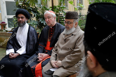 Cardinal Vincent Nichols, Archbishop of Westminster, center, Ali Raza Rizvi, left, and Muhammad Shahid Raza, chairman of the British Muslim Forum answer questions during an interview with The Associated Press, at Rome's English College, . Pope Francis is meeting with four British imams two weeks after the Westminster attack, part of his effort to give prominence and a platform to Muslim leaders who renounce using religion to justify violence