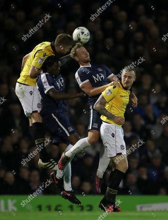 David Wheather and Mark Beevers of Bolton Wanderers sandwich Nile Ranger and Michael Timlin of Southend during the Sky Bet League One match between Southend and Bolton Wanderers played at Roots Hall, Southend on 4th April 2017