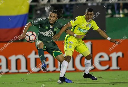 Farid Alfonso Diaz Rhenals of Colombia's Atletico Nacional, right, fights for the ball with Apodi of Brazil's Chapecoenseduring a Recopa Sudamericana first leg final soccer match in Chapeco, Brazil