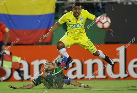 Farid Alfonso Diaz Rhenals of Colombia's Atletico Nacional, top, fights for the ball with Apodi of Brazil's Chapecoense during a Recopa Sudamericana first leg final soccer match in Chapeco, Brazil