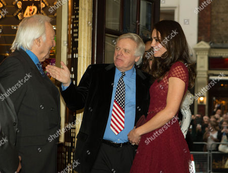 Catherine Duchess of Cambridge with Lord Michael Grade and Michael Linnit (left) as she arrives for the opening night of the musical 42nd Street, in aid of East Anglia's Children's Hospice at the Theatre Royal, Drury Lane, London