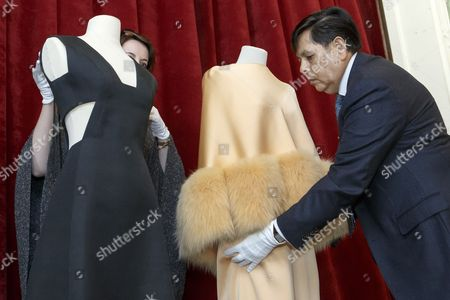 """Anna-Lina Corda, left, of the Musee Suisse de la Mode, and Antonio Villaverde, right, curator of Musee Suisse de la Mode, remove dresses of the Countess von Galen created by Hubert de Givenchy, during the presentation of the exhibition """"Audrey Hepburn & Hubert de Givenchy: une elegante amitie"""", in Morges, Switzerland, 05 April 2017. The exhibition """"Audrey Hepburn & Hubert de Givenchy: une elegante amitie"""" (English: """"Audrey Hepburn & Hubert Givenchy: """"An elegant friendship"""") will take place from May 20 to September 17, 2017, at the Expo Fondation Bolle in Morges."""