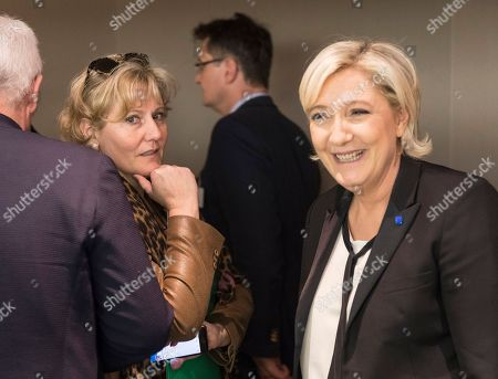 Members of the European Parliament Marine Le Pen, right, and Nadine Morano are pictured at the European Parliament in Strasbourg, eastern France,. European Union lawmakers on Wednesday passed a resolution calling for phased negotiations in divorce proceedings with Britain, going against the wishes of London, which would like exit talks and discussions of a future trade arrangement to happen in parallel