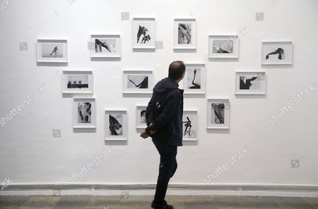 A man looks at artworks by Lebanese artists Joana Hadjithomas and Khalil Joreige during the presentation of the exhibition 'Two Suns in a Sunset / Se Souvenir de la Lumiere' at the Modern Art Institute of Valencia (IVAM) in Valencia, Spain, 05 April 2017. The exhibition on Hadjithomas and Joreige's impressions of destruction in Beirut will open to the public from 06 April to 27 August.