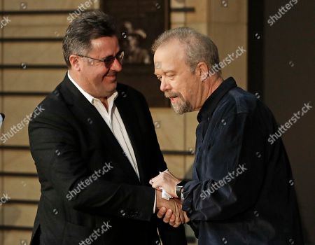 Stock Image of Don Schlitz, Vince Gill Songwriter Don Schlitz, right, is congratulated by emcee Vince Gill after Gill announced, in Nashville, Tenn., that Schlitz is one of the 2017 inductees into the Country Music Hall of Fame along with singer and songwriter Alan Jackson and the late singer and songwriter Jerry Reed
