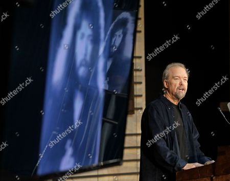 Stock Photo of Songwriter Don Schlitz speaks as as an old photo of him appears on a screen, in Nashville, Tenn., at a news conference announcing that he is one of the 2017 inductees into the Country Music Hall of Fame. Schlitz will be honored with singer and songwriter Alan Jackson and the late singer and songwriter Jerry Reed