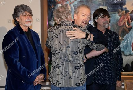 Stock Picture of Don Schlitz, Randy Owen, Teddy Gentry, Joe Bonsall Songwriter Don Schlitz, second from right, gets a hug from Joe Bonsall of The Oak Ridge Boys after the announcement was made, in Nashville, Tenn., that Schlitz is one of the 2017 inductees into the Country Music Hall of Fame along with singer and songwriter Alan Jackson and the late singer and songwriter Jerry Reed. Behind Schlitz are Randy Owen, left, and Teddy Gentry, right, of the group Alabama