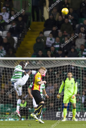 Eboue Kouassi of Celtic challenge on Andrew McCarthy of Partick Thistle during the SPFL Ladbrokes Premiership match between Celtic & Partick Thistle at Celtic Park, Glasgow on 5th April