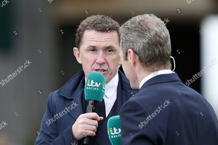 itv racing commentator Tony McCoy speaks with Mick Fitzgerald during day one of the Randox Health Grand National festival held at Aintree, Liverpool on 6th April, 2017