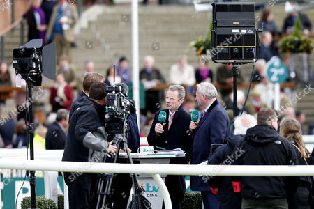 itv racing correspondent Mick Fitzgerald speaks to camera in the paddock during day one of the Randox Health Grand National festival held at Aintree, Liverpool on 6th April, 2017