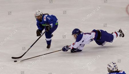 Louise Adams, Sara Confidenti Britain' Louise Adams, right, fights for the puck with Slovenia's Sara Confidenti during their IIHF Ice Hockey Women's World Championship Division II Group A game in Gangneung, South Korea