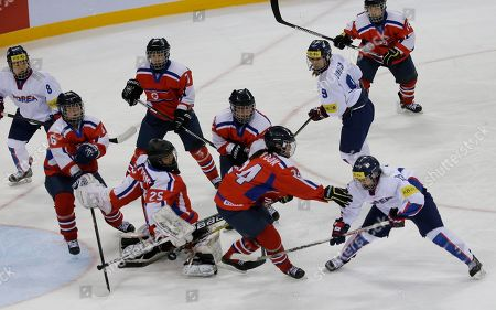 Lee Eun-ji, Kim Kum Bok South Korea's Lee Eun-ji, bottom right, scores a goal as North Korea's Kim Kum Bok, bottom second right, tries to block the puck during their IIHF Ice Hockey Women's World Championship Division II Group A game in Gangneung, South Korea