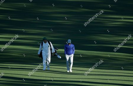 Trevor Immelman of South Africa, walks up the second hole during the first round for the Masters golf tournament, in Augusta, Ga